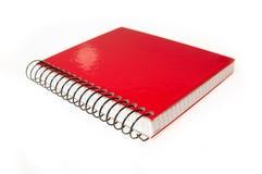 Libro rojo cerrado - detalle Foto de archivo