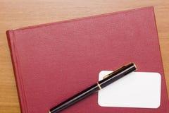 Libro rosso del biglietto da visita Fotografie Stock
