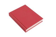 Libro rosso della libro con copertina rigida su priorità bassa bianca Immagine Stock