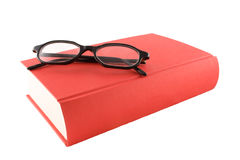 Libro rosso e glasses1 nero Fotografia Stock