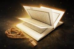 Libro sagrado y gotas del Quran imagen de archivo