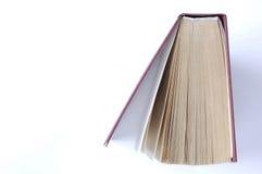 Libro su priorità bassa bianca Fotografia Stock