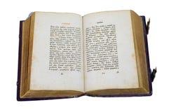 Libro viejo abierto aislado en el blanco Imagen de archivo libre de regalías