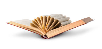 Libro viejo entornado con las páginas encrespadas imagen de archivo