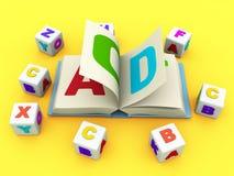 Libro y bloques del ABC en el fondo amarillo Foto de archivo libre de regalías