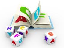 Libro y bloques del ABC en el fondo blanco Imagen de archivo libre de regalías