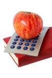 Libro y calculadora de Apple imagenes de archivo