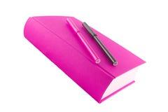 Libro y etiquetas de plástico rosados Fotografía de archivo libre de regalías
