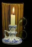 Libro y Gl de la vela; asnos Imagen de archivo