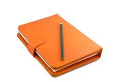Libro y lápiz Fotos de archivo libres de regalías