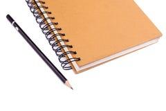 Libro y lápiz imagen de archivo libre de regalías