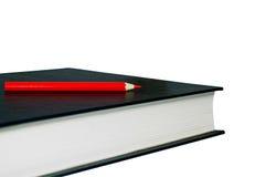 Libro y lápiz. con el camino de recortes Fotografía de archivo libre de regalías