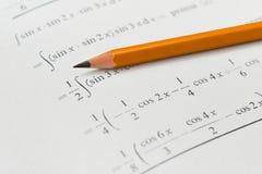 Libro y lápiz de la matemáticas Fotos de archivo libres de regalías