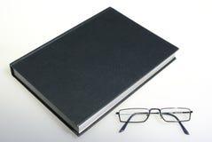 Libro y vidrios Foto de archivo libre de regalías