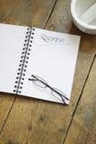 Libro y vidrios de la receta Foto de archivo