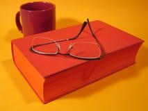 Libro y vidrios rojos III Fotos de archivo libres de regalías
