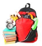 Libros, accesorios de la escuela y una mochila Imagen de archivo libre de regalías