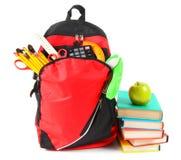Libros, accesorios de la escuela y una mochila Imagen de archivo