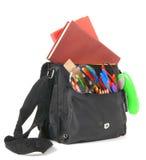 Libros, accesorios de la escuela y una mochila Fotografía de archivo