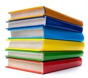 Libros coloridos en el fondo blanco imagen de archivo