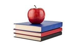 Libros con las manzanas Imagen de archivo