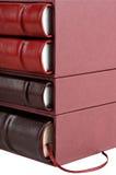 Libros de cuero rojos y marrones Imagenes de archivo