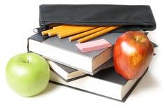 Libros de escuela con la caja de lápiz Imágenes de archivo libres de regalías