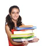 Libros de escuela de la explotación agrícola de la chica joven Foto de archivo