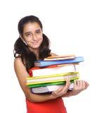 Libros de escuela de la explotación agrícola de la chica joven Foto de archivo libre de regalías