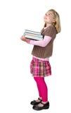 Libros de la explotación agrícola de la muchacha de la escuela y mirada para arriba Imagen de archivo libre de regalías