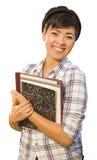 Libros de la explotación agrícola del estudiante femenino de la raza mezclada aislados Foto de archivo libre de regalías