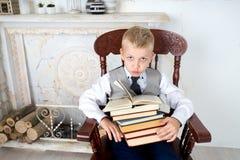 Libros de la explotación agrícola del muchacho Imagen de archivo libre de regalías