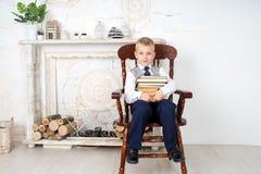 Libros de la explotación agrícola del muchacho Foto de archivo libre de regalías