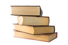 Libros de la pila fuera de los cuatro pedazos Foto de archivo