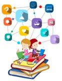 Libros de lectura del muchacho y de la muchacha Fotografía de archivo libre de regalías