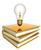 Libros de oro y bulbo creativo Foto de archivo