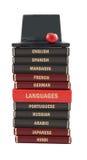Libros de texto del lenguaje y computadora portátil Fotos de archivo libres de regalías