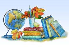 Libros de texto, el globo, lápices, hojas de otoño en una tabla Imagen de archivo libre de regalías