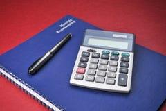 Libros del asunto, calculadora, costos, contabilidad Foto de archivo libre de regalías