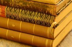 Libros del vintage con tacto de oro Imágenes de archivo libres de regalías