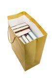 Libros en bolsa de papel Imagenes de archivo
