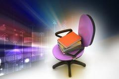 Libros en el top de la silla Foto de archivo libre de regalías