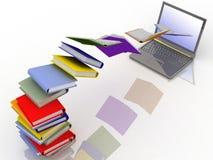 Libros en la computadora portátil Imagenes de archivo