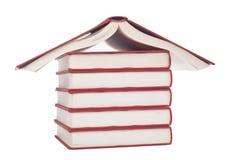Libros formados como una casa Fotografía de archivo