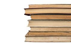 Libros gastados viejos sucios, fondo, aislamiento en un blanco foto de archivo