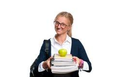 Libros jovenes felices de la explotación agrícola de la muchacha del estudiante De nuevo a escuela Imágenes de archivo libres de regalías