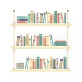 Libros planos del diseño en estante de la cuerda Foto de archivo libre de regalías
