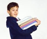 Libros que llevan del muchacho Fotografía de archivo