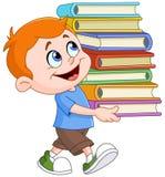 Libros que llevan del muchacho Imagen de archivo libre de regalías
