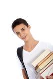 Libros que llevan sonrientes del adolescente Fotografía de archivo libre de regalías